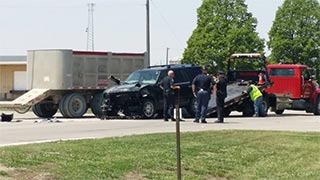 an suv getting loaded onto a tow truck